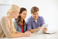 Smiling students with tablet pc computer at school Royalty Free Stock Photography