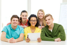 Smiling students with tablet pc computer at school Royalty Free Stock Images