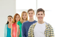 Smiling students with teenage boy in front Stock Photo