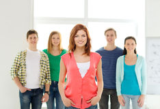 Smiling students with teenage girl in front Royalty Free Stock Photos