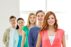 Smiling students with teenage girl in front Stock Photo