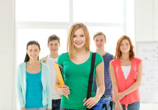 Smiling students with teenage girl in front Stock Photos
