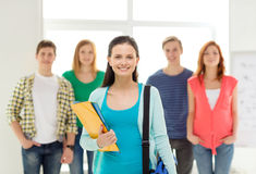 Smiling students with teenage girl in front Royalty Free Stock Photography
