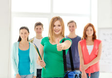 Smiling students with teenage girl in front Royalty Free Stock Photo