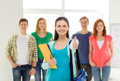 Smiling students with teenage girl in front Stock Photography
