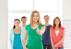 Smiling students with teenage girl in front Stock Images