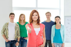 Smiling students with teenage girl in front Stock Image