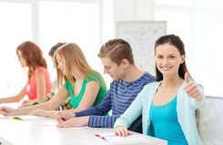 Smiling students with textbooks at school Stock Image