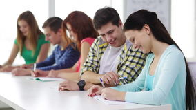 Smiling students with textbooks at school stock footage