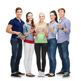 Smiling students using smartphones and tablet pc Stock Photography