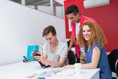 Smiling students working with camera together Royalty Free Stock Photo