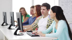 Smiling students working with computers at school stock footage
