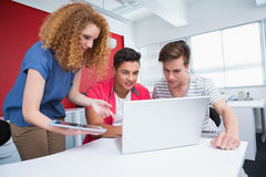 Smiling students working with laptop and tablet Royalty Free Stock Photo