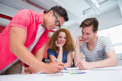 Smiling students working and taking notes together Royalty Free Stock Images
