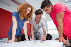 Smiling students working and taking notes together Royalty Free Stock Photography