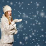 Smiling stylish blonde woman in warm white knitted scarf, hat, l Stock Photos
