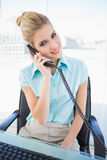Smiling stylish businesswoman answering the phone Stock Photos
