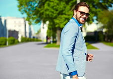 Smiling stylish handsome man in suit in the street stock photos