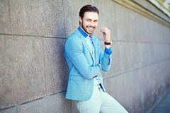 Smiling stylish handsome man in suit in the street Stock Image