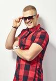 Smiling stylish man in sunglasses Stock Image