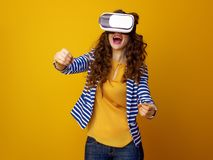 Smiling stylish woman wearing cardboard VR glasses and driving Stock Images