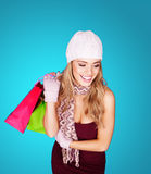Smiling stylish woman with shopping bags Stock Image