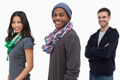 Smiling stylish young people in a row Stock Photo