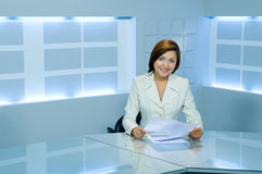 Smiling success business lady at office. Smiling caucasian business lady at office desk royalty free stock image