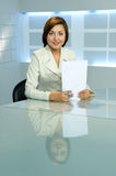 Smiling success business lady at office. Smiling business lady with papers at office stock photo