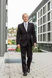Smiling successful business man in black suit outdoor Royalty Free Stock Photography