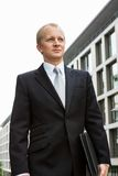 Smiling successful business man in black suit outdoor stock images