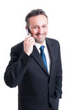Smiling and successful business man talking on the phone Stock Photos
