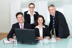 Smiling successful business team Stock Photos