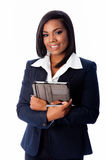 Smiling successful business woman standing with tablet Stock Photography