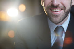 Smiling Successful Businessman with lens Flare Stock Photography
