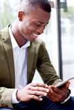 Smiling successful businessman with tablet pc outdoor. In summer Stock Images