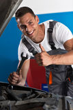Smiling successful mechanic Royalty Free Stock Images
