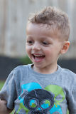 Smiling summer boy. Excited Happy Young toddler boy looking away Royalty Free Stock Image