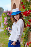Smiling summer woman with hat and sunglasses Royalty Free Stock Image