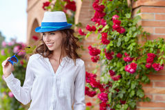 Smiling summer woman with hat and sunglasses Stock Image