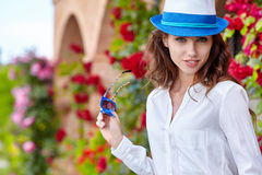 Smiling summer woman with hat and sunglasses Stock Photo
