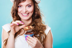 Smiling summer woman holds cakes in hand Stock Images