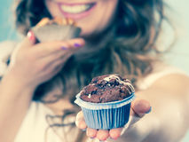 Smiling summer woman holds cakes in hand Stock Photos