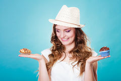 Smiling summer woman holds cakes in hand Stock Photography