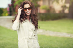 Smiling summer woman with sunglasses in garden Royalty Free Stock Images