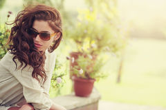 Smiling summer woman with sunglasses in garden Stock Photos