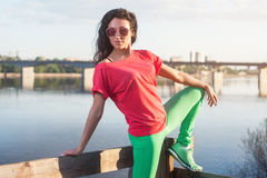 Smiling summer woman wearing sunglasses near river. Stock Image