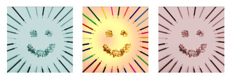 Smiling sun arranged from crayons and  pencil crayons shavings. Triptych in green,brown and natural colour.  Stock Photography
