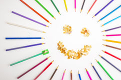 Smiling sun arranged from crayons and pencil sharpenings. Stock Images