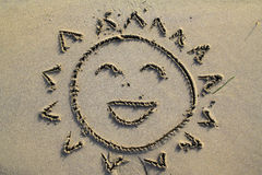 Smiling sun in the beach Royalty Free Stock Images